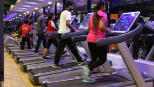 Gym Members on Treadmill