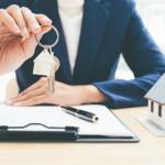 salesman with home keys